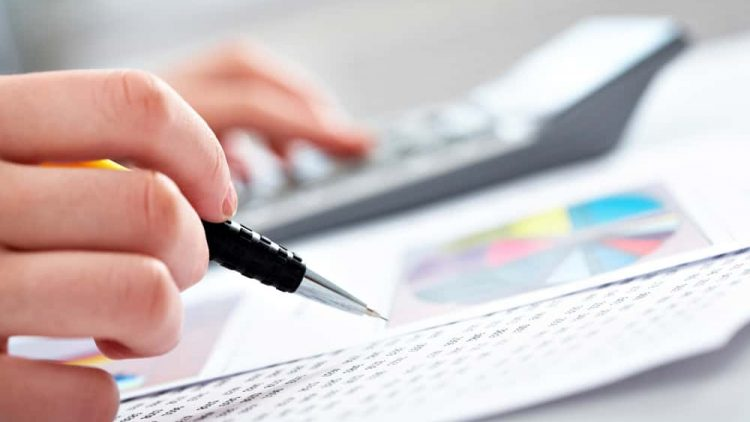 Close-up of a pen and financial documents